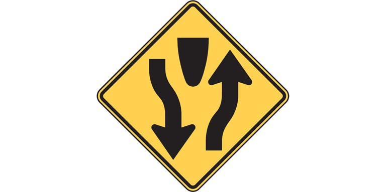 Mixed up signs - W6-1 Divided Highway Begins
