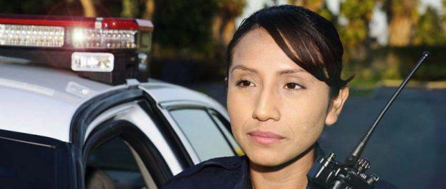 Hispanic police officer - copyright: John Roman