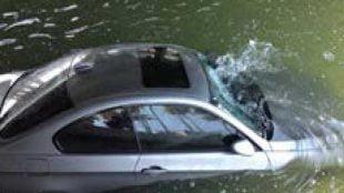 Car sinking in water