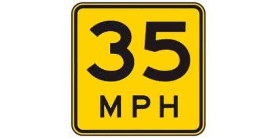 Yellow advisory speed sign