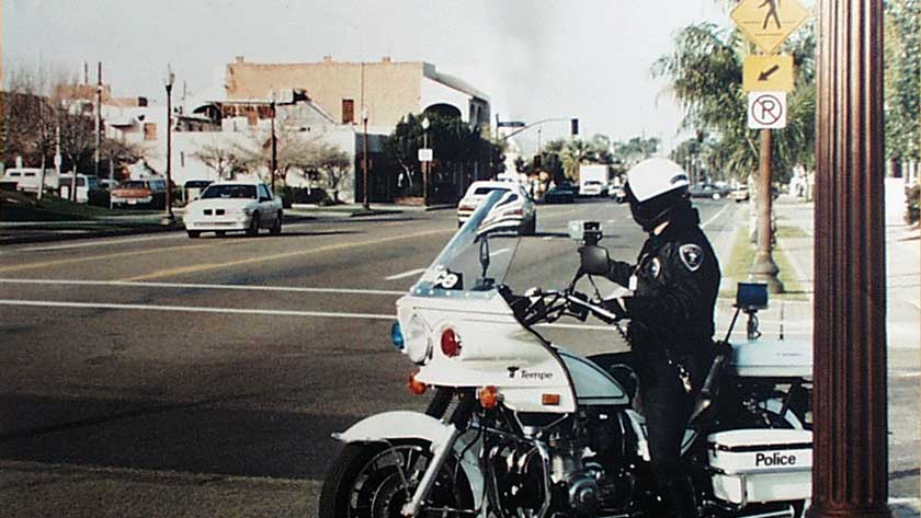 Motorcycle Police Officer at intersection - NHTSA