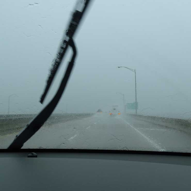 Vehicles with emergency flashers in rain