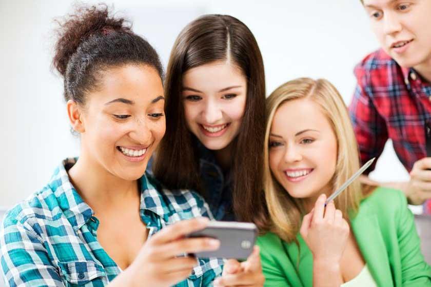 Friends checking phone - Copyright:  dolgachov
