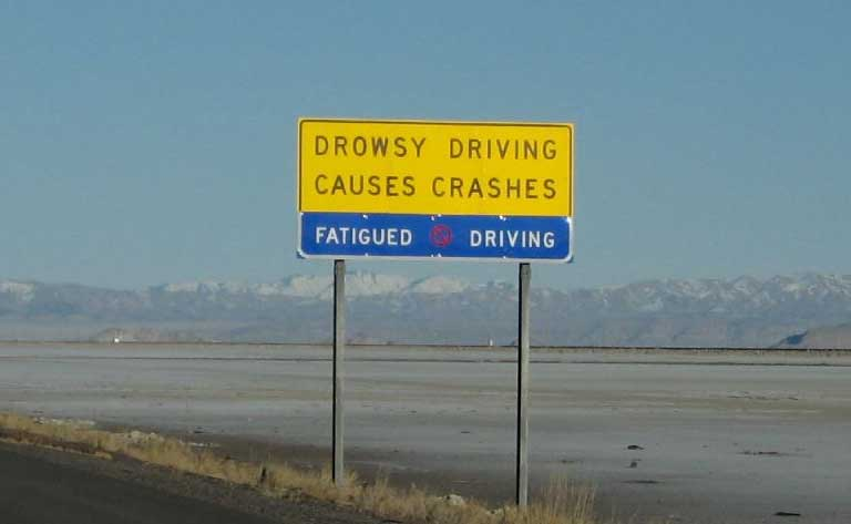drowsy driving road sign by Ken Lund